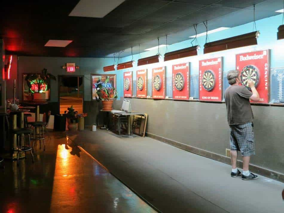 Playing darts alone in a pub